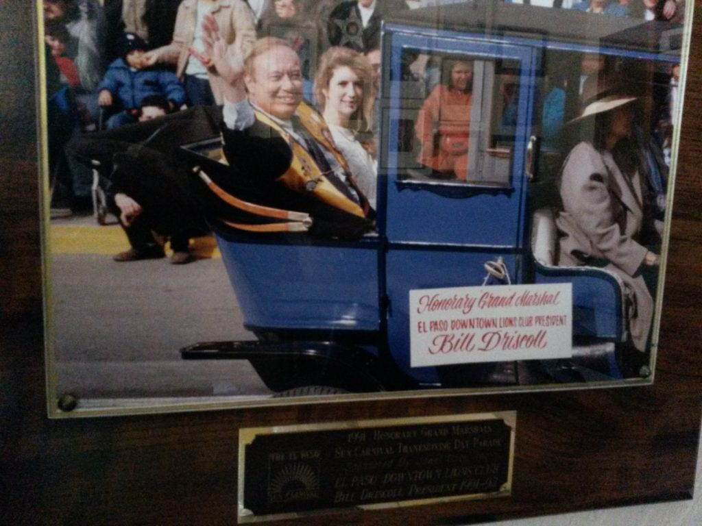 1991 Bill Driscoll waving Sun Bowl parade Honorary Grand Marshall with daughter, Teri